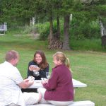 Guests playing cards outside